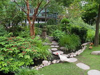 Beautiful classical landscaped Japanese garden with water stream and walkpath