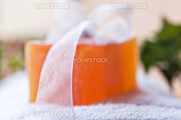 Handmade soap and towel in a spa - very shallow depth of field