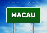Green Macau highway sign on Cloud Background.