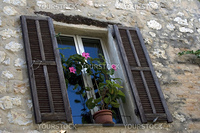 Nice window with the flowerpot in medieval house