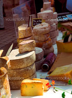 Assorted cheeses for sale on french farmers market in Perigueux, France