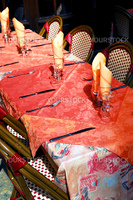 Set table with tablecloth and glasses on restaurant outdoor patio