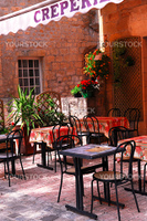 Restaurant patio in medieval town of Sarlat, France