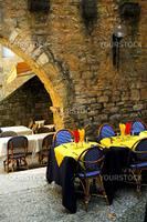 Restaurant patio among medieval walls in Sarlat, Dordogne region, France