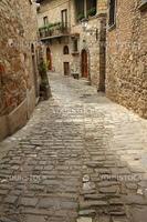 narrow stony street in italian medieval village Montefioralle,Tuscany, Europe