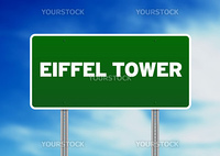 Green Eiffel Tower highway sign on Cloud Background.
