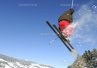 Jumping skier having fun in mountain in winter