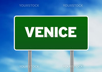 Green Venice highway sign on Cloud Background.