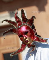 Image of a red venetian mask with bells.