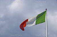 italian flag blowing in the wind on a cloudy day