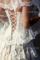 Backside of a beautiful dress of a bride