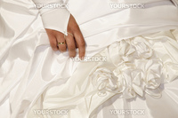 hand on wedding dress