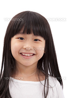 Close-up portrait of Asian little girl on white background