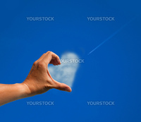 The love symbol by hand and cloud