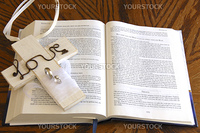 white love crucifix with rings laying on open bible