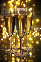 Champagne in glasses and blured lights on background