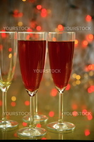 Champagne in glasses and twinkle lights on background