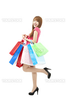 happy Beautiful woman with a lot of shopping bags