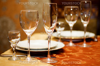 Glasses on Restaurant Table before big Party begins