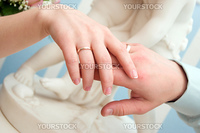 Married couple shows off rings.wedding ring