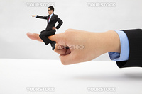 Business concept.Businessman sitting on the finger shouting and blaming
