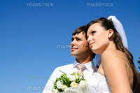 bride and groom and blue sky on the background
