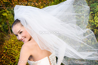 a smiling beautiful bride with fly veil
