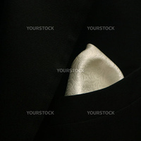 a close up image of grooms tuxedo