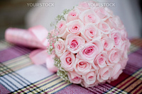 Wedding bouquet with pink roses on checkered backgdrop