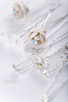 Group of silver wedding hearpins on white background
