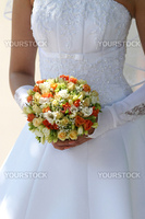 Multi-coloured bouquet in the hands of bride.