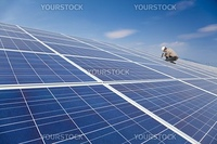 close up solar panel and professional worker installing photovoltaic solar panels