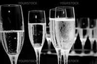 black and white champagne glasses at a function.