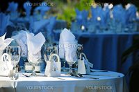 A round table set for a wedding reception in the open air (cropped)