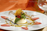 pudding with a caramel, decorated pearls and mint