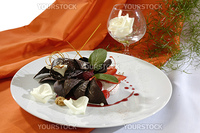 chocolate dessert with a caramel, decorated white petals or rose and mint