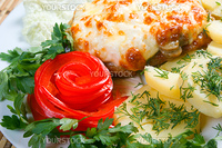 meat with potatoes and vegetable.Italian kitchen.Close-up