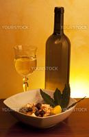 octopus salad with olives on orange gradient background