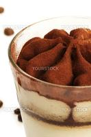 tiramisu soft focus closeup on white background with coffee beans