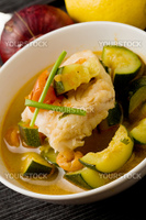 photo of delicious fish soup with cod and zucchini