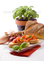 photo of delicious italian bruschetta with basil and ingredients