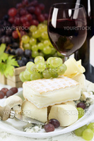 Grape and cheese with a bottle and glasses of red  wine