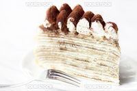 Portion of Tiramisu Mille crepe on a plate
