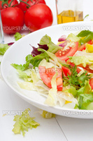 Healthy Salad of Fresh Green Vegetables on White Plate