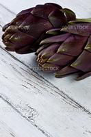 artichokes on a white wood