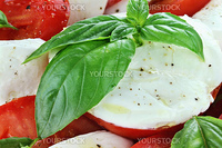 Extreme close up of freshly prepared delicious caprese salad.