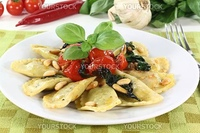 Rocket and Ricotta Cappelletti with pine nuts, tomatoes and basil
