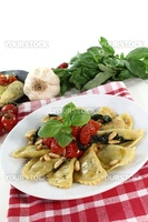 fresh Rocket and Ricotta Cappelletti with pine nuts, tomatoes and basil