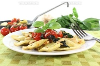 Rocket and Ricotta Cappelletti with pine nuts, tomatoes and fresh basil