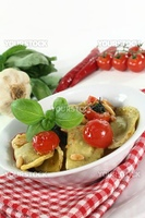 cappelletti with melted tomatoes and roasted pine nuts